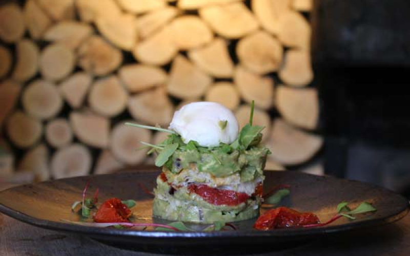 Avocado millefeuille with poached egg